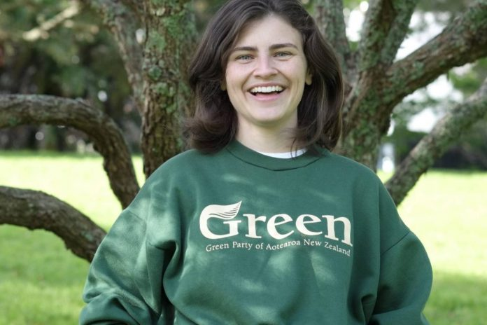 chloe_swarbrick_wearing_green_sweatshirt